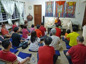 Ven. Lama Dondrup Dorje giving Dharma teaching to students in Singapore