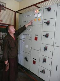 Lopon Jigmed Namgyal, the project manager of the Shedra Construction Project, at the Power Control Panel