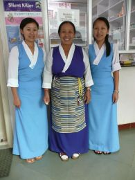 Three of the Nurses with their new Tibetan-style uniforms