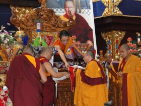HH Karma Kuchen Rinpoche, the 12th Throne Holder of the Palyul Lineage confers degrees and ceremonial hats on new Khenpos at Namdroling Monastery