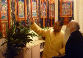 Ven. Lama Dondrup Dorje showing His Excellency the thangkas