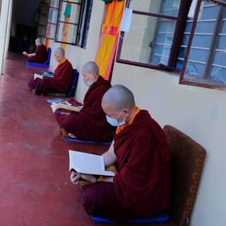 Nuns reciting prayers outside their rooms maintaining safe distancing