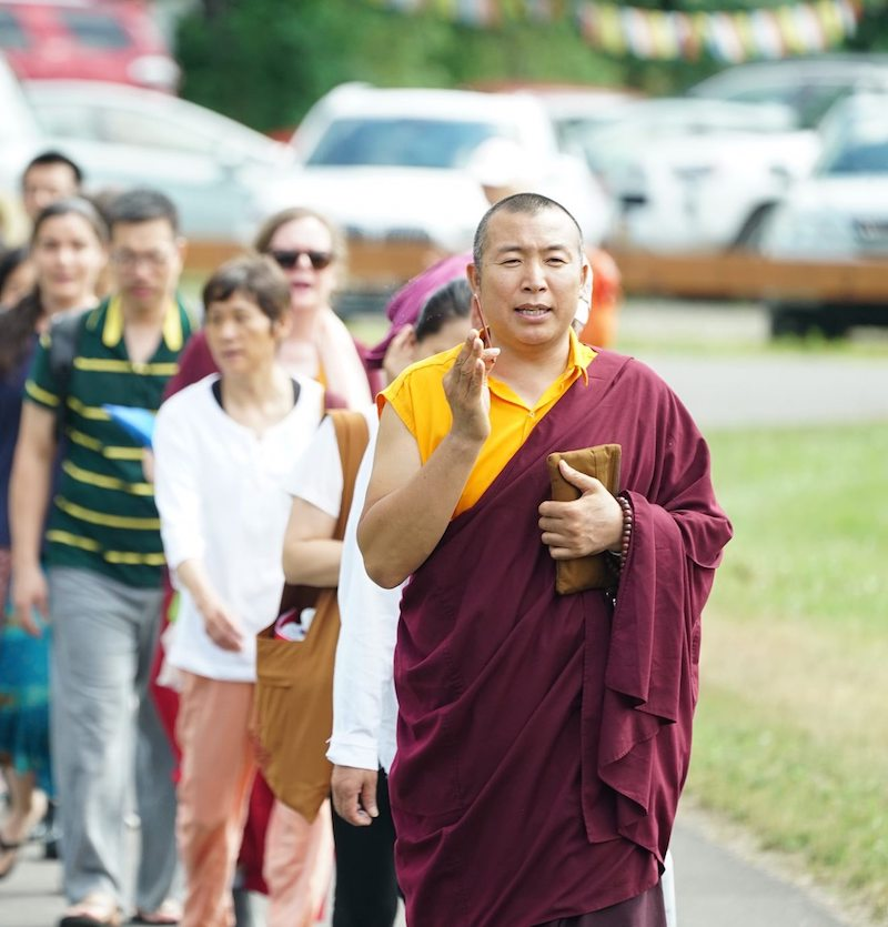 Lopon Rapjee Wangchuk leading students to perform circumambulation of the temple at the Palyul Retreat Centre before the epidemic crisis