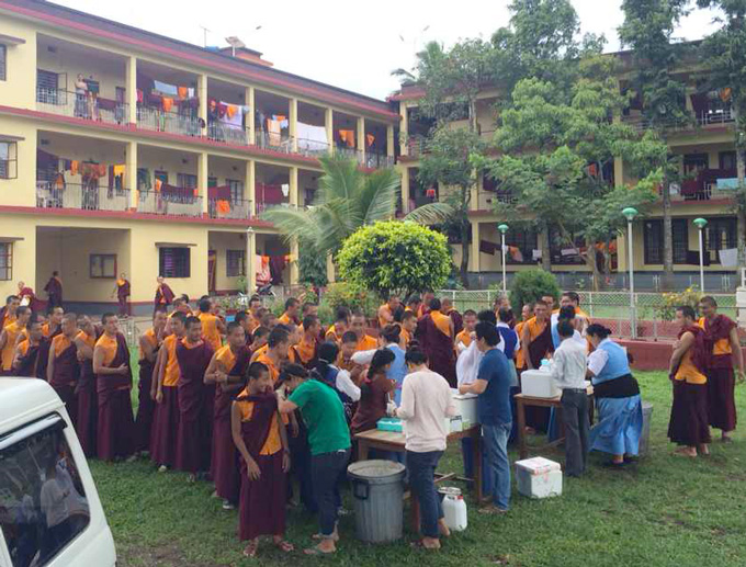 Monks receive vaccination at Namdroling Monastery