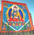 The world's largest thangka of Guru Rinpoche, raised at Namdroling Monastery.