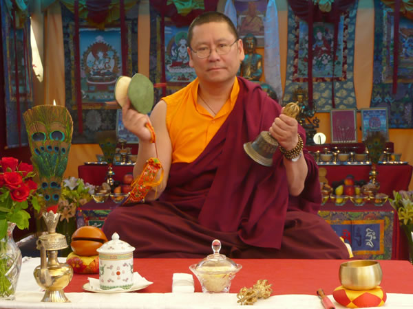 Lama Dondrup Dorje with the bell and damaru given to him by the late Holiness Penor Rinpoche